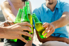 Friends cheers their beers at a party Stock Photo