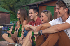 Free Friends Chilling Near Lake Royalty Free Stock Images - 45194549