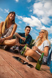 Friends Chilling Near Lake. Group Of Cheerful Friends Chilling Near Lake royalty free stock image