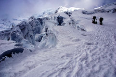 Friends on Chipicalqui glacier near big crevases Stock Images