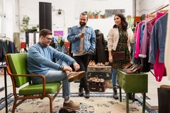 Friends choosing clothes at vintage clothing store Royalty Free Stock Image