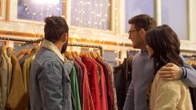 Friends choosing clothes at vintage clothing store stock video footage