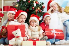 Friends by Christmas tree Stock Photos