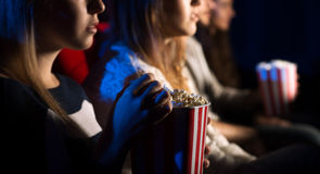 Friends at the cinema watching a movie Royalty Free Stock Photos