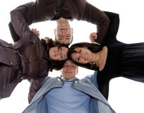 Friends' circle. Group of four smiling young people in circle Royalty Free Stock Photography