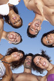 Friends in a circle looking down Royalty Free Stock Photography