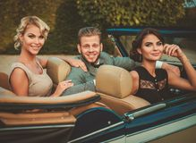 Friends in a classic car Stock Photography