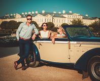 Friends in a classic convertible Stock Photography