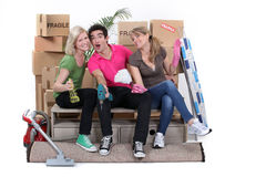 Friends cleaning house Royalty Free Stock Photography