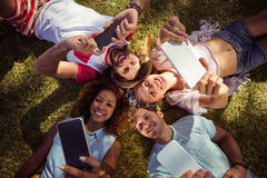 Friends clicking selfie on mobile phones Stock Photography