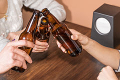 Friends clink bottles Royalty Free Stock Photos