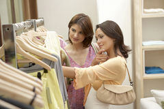Friends in Clothes Store Stock Photos