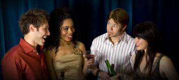 Friends at club. Attractive friends at a club drinking Royalty Free Stock Image