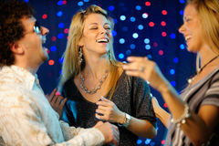 Friends clubbing. Horizontal image of happy friends dancing Royalty Free Stock Photo