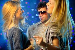 Friends clubbing. Horizontal image of happy friends dancing Royalty Free Stock Images
