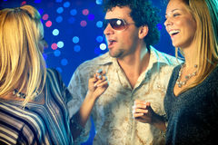 Friends clubbing Stock Photography