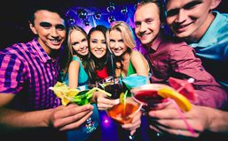 Friends with cocktails Stock Images