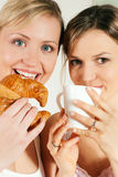 Friends with coffee and croissant Stock Images