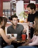 Friends in a Coffee House Royalty Free Stock Photos