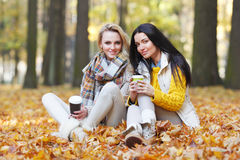 Friends with coffee in park Royalty Free Stock Photography