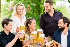 Friends or colleagues on beer garden after work Stock Image