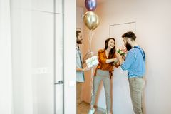 Friends coming home for a birthday party stock image