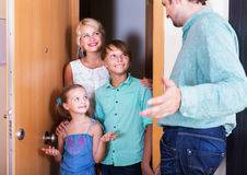 Friends coming with visit. Family friends coming at threshold with visit. Focus on boy Royalty Free Stock Images