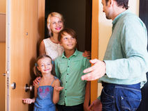 Friends coming with visit. Happy family coming at threshold with visit to friend. Focus on boy Stock Image