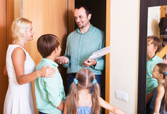 Friends coming with visit. Man coming at threshold with visit to friends family Royalty Free Stock Images