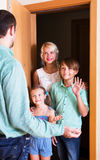 Friends coming with visit. Smiling family coming at threshold with visit to friend. Focus on boy Stock Photography