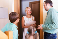 Friends coming with visit. Woman coming at threshold with visit to friends family Stock Photography