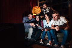Friends company play video game, fun entertainment Royalty Free Stock Images