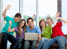 Friends with a computer Royalty Free Stock Photos
