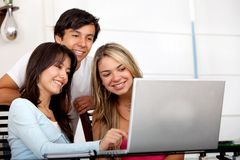 Friends with a computer Stock Images