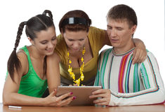 Friends with computer tablet Stock Photos
