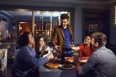 Free Friends Congratulate A Friend At A Dinner In A Restaurant. Stock Photo - 158780380