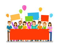 Friends with a congratulatory banner in hands. Holiday. Happy birthday.  Royalty Free Stock Image