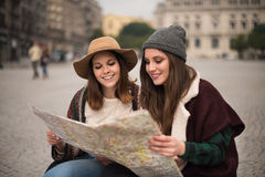 Friends consulting a city map Royalty Free Stock Photo