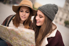 Friends consulting a city map Stock Images