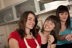 Friends cooking together Royalty Free Stock Images