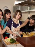 Friends cooking together royalty free stock photos
