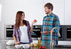 Friends cooking together Royalty Free Stock Photo