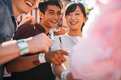 Friends with cotton candy outdoors Royalty Free Stock Photography