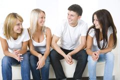 Friends on a couch Royalty Free Stock Images