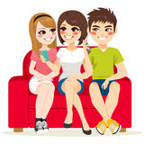 Friends Couch Smartphone. Friends together sitting on couch talking and using smartphone Royalty Free Stock Photo