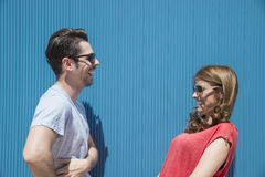 Friends or couple laughing and taking a conversation against a b Royalty Free Stock Images