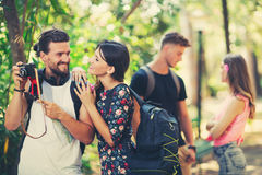 Friends or couples having fun with photo camera in park Royalty Free Stock Photography