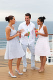 Friends on cruise. Group of friends on cruise having cocktails Stock Photo