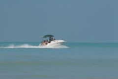 Friends crusing. Friends enjoying fast boat crusing the blue waters of the ocean Stock Image