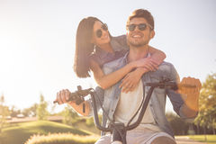 Friends cycling in park Stock Photography